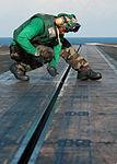 Filing down burs aboard the USS George Washington DVIDS128356.jpg