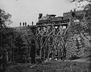 "Orange and Alexandria Railroad - The engine ""Firefly"" on a trestle of the Orange and Alexandria Railroad."