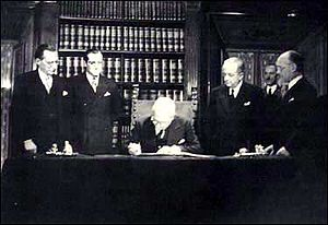 Constitution of Italy - The provisional head of state, Enrico De Nicola, signing the Constitution by virtue of Provision XVIII, on 27 December 1947.