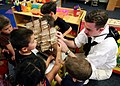 Flickr - Official U.S. Navy Imagery - A Sailor shows students of Little Big Minds pre-school, a model of an 1812-era square rig ship, during Phoenix Navy Week..jpg
