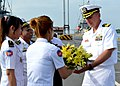 Flickr - Official U.S. Navy Imagery - USS Vandegrift CO receives flowers in Cambodia..jpg