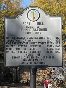 Large cast embossed concrete or metal panel atop a metal post. Embossing gives dates of other senators and politicians as well as Calhoun's son-in-law.
