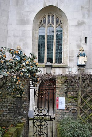 Foundling Hospital - The same statues from the Foundling Hospital located in Hatton Garden are above the side door of the near St Andrew Holborn. Thomas Coram, founder of the Foundlings' Hospital is buried here, his remains were translated from his foundation in the 1960s.
