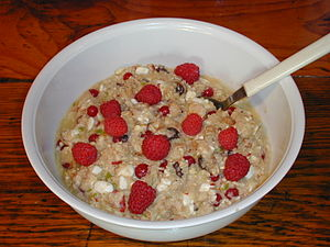 Muesli - Fresh muesli, made using rolled oats, orange juice, blended apple and banana, redcurrants, raisins and cottage cheese, topped with raspberries.