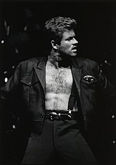 A man with an open shirt