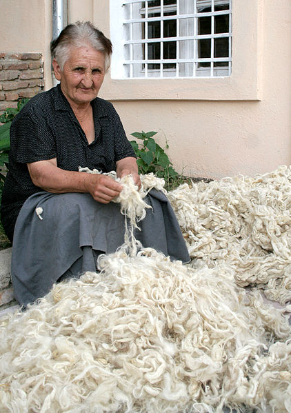 [Image: 422px-Georgian_woman_carding_wool.jpg]