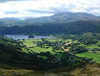 Grasmere village and lake as seen from the fell of Stone Arthur