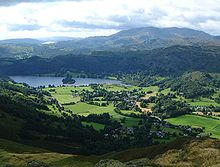 K Village Lake District Grasmere village and lake as seen from the fell of Stone Arthur
