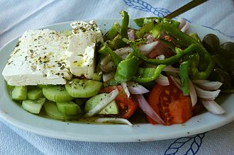 Greek salad - Horiatiki salad with Feta cheese as served on Hydra Island, where cucumber is peeled. In other regions, cucumbers are left unpeeled.