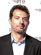 Guy Oseary in a coat smiling