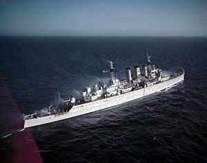HMS Cumberland (57) sparying decks during anti-nuclear warfare tests 1955.jpg