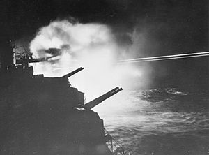 HMS Mauritius (80) - The 6-inch guns of Mauritius firing during a night action in Audierne Bay between Brest and Lorient, France, 23 August 1944.
