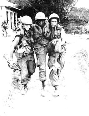 A wounded African-American soldier being carried away, 1968 Haeberlewounded.jpg