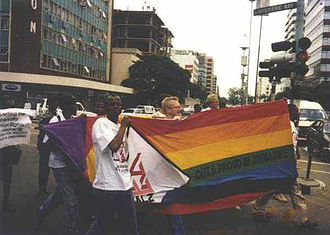 Scott Long - Queer activists joined by Scott Long (center, behind flag) participate in Zimbabwe's first-ever LGBT rights march on Human Rights Day, December 10, 1998, in Harare