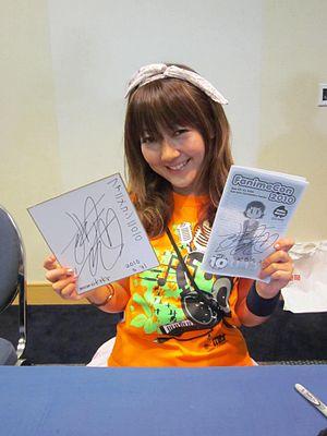 Haruko Momoi - Haruko Momoi at an autograph signing at FanimeCon 2010 in San Jose, California, U.S..