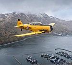 Harvard MkIV from CAF Alaska overflying Dutch Harbor Unalaska.jpg
