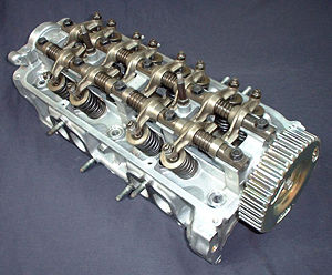 A cylinder head from a 1987 Honda CRX Si showi...