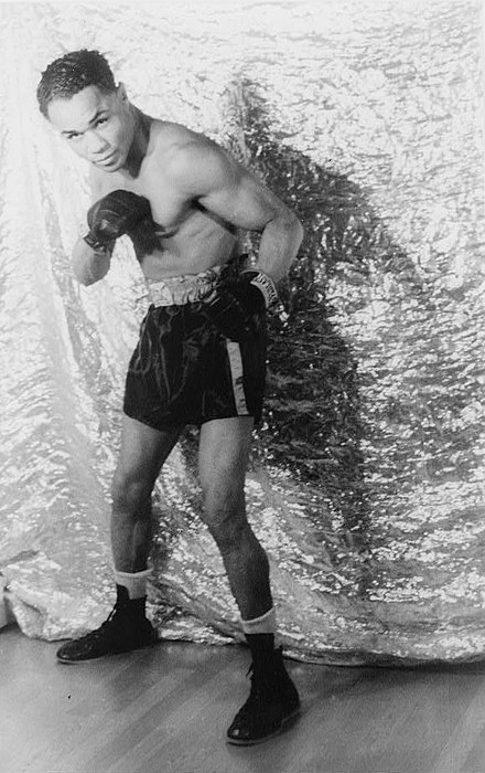 Henry Armstrong was known for his aggressive, non-stop assault style of fighting. Henry Armstrong 1937.jpg