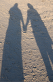 Holding Hands shadow on sand cropped.png