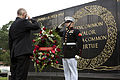 Honorary Marine Daran Wankum, left, salutes during a wreath laying ceremony at the Marine Corps War Memorial in Arlington, Va, June 13, 2013 130613-M-KS211-007.jpg