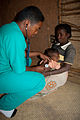 Hoveraid Dr treating baby.jpg
