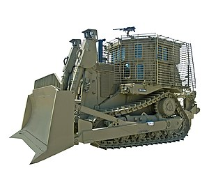 "Armored bulldozer - An IDF Caterpillar D9. This is a Caterpillar D9R bulldozer with Israeli armor, used by the Israeli Defense Forces (nicknamed ""דובי"" (Teddy bear).   Its armor allows it to work under heavy fire."