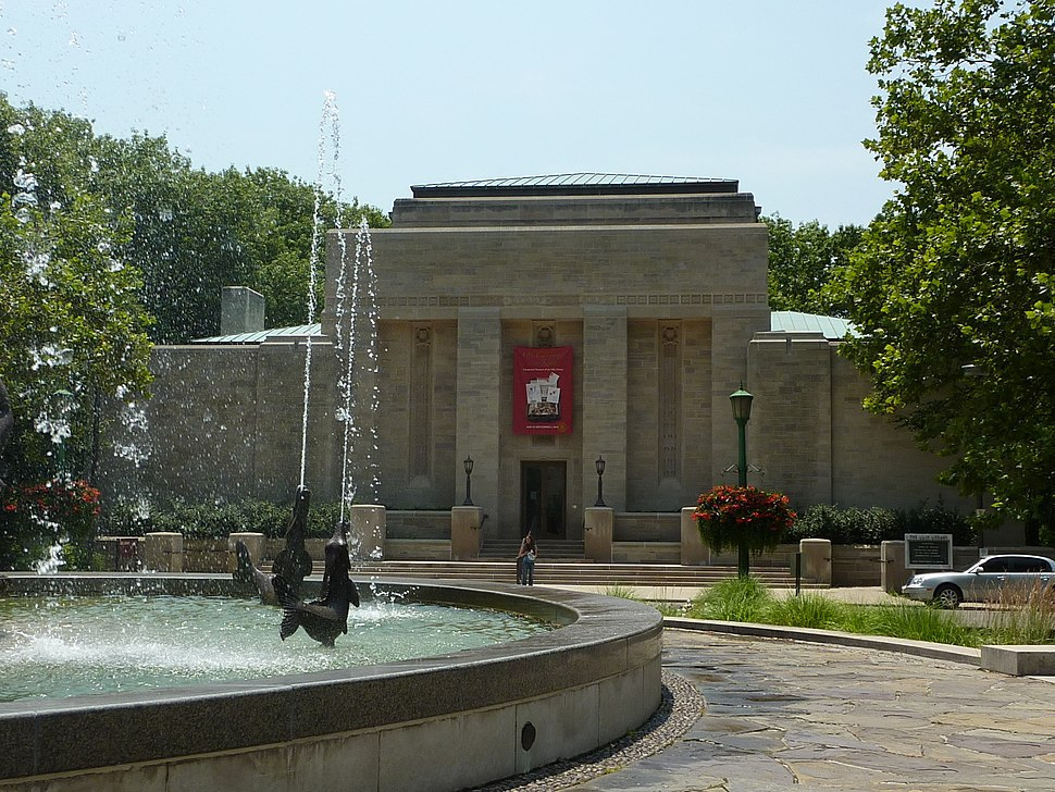 an exterior photograph of the Lilly Library with the Showalter Fountain in the foreground