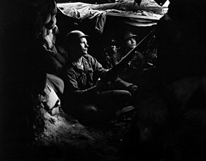 Battle of Heartbreak Ridge - U.S. Army infantrymen of the 27th Infantry Regiment, near Heartbreak Ridge, take advantage of cover and concealment in tunnel positions, 40 yards from the Communists on August 10, 1952.
