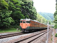 JNR 113 in Shonan livery C3 set local on Sagano Line (San'in Main Line).jpg