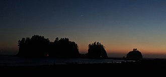 James Island (La Push, Washington) - After sunset, with Venus visible in the sky, and red and green harbor channel markers visible at the entrance to the Quillayute River
