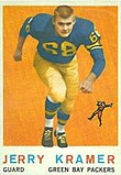 "A color photo of a Jerry Kramer running towards the camera, with the text ""Jerry Kramer, Guard, Green Bay Packers"" in a black bar below the photo"