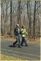 Jimmy Carter and Rosalynn Carter stroll within Camp David - NARA - 178942.tif