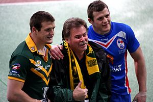 2009 Rugby League Four Nations - The Morris twins celebrate their team's win with father Steve.