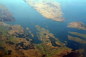 Gulf of Corryvreckan - An aerial photograph, facing southwest, of the Gulf of Corryvreckan and its surroundings. The two islands to the top right are Jura (the larger one) and Scarba; the Gulf of Corryvreckan lies between them. Stretching off to the top left is the Sound of Jura.