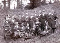 The curriculum of Jyväskylä Teacher seminary included gymnastics. Seminarians of the Female section in gym suits with gymnastic staffs in 1897