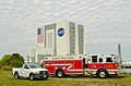 KSC fire engine and pickup truck in front of VAB.jpg