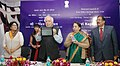 Kapil Sibal launching the Core Banking – Postal Life Insurance Solutions, at a function, in New Delhi on March 01, 2014. The Secretary, Department of Posts, Smt. Padmini Gopinath is also seen.jpg