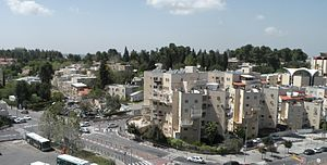 Kanfei Nesharim Street - The Kfar Shaul Mental Health Center (left) occupies the remaining buildings of the village of Deir Yassin.