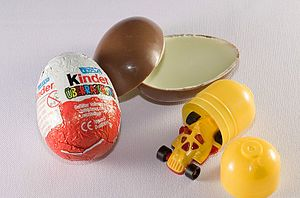 Kinder Surprise - Kinder Surprise is a chocolate egg that contains a toy inside a plastic shell.