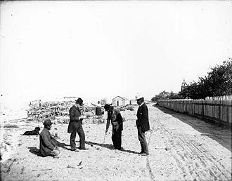 Klallam - Klallam men on beach with the Shaker church in the background, Jamestown, Washington, ca. 1903