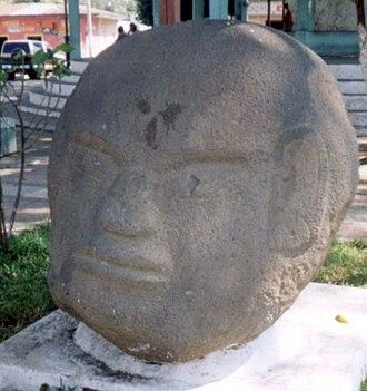 Potbelly sculpture - Colossal head in potbelly style on display in La Democracia, Escuintla and originally from Monte Alto.