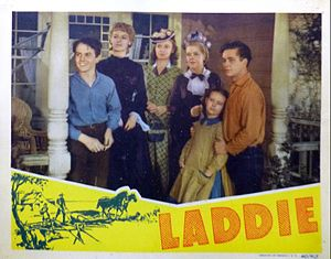 Joan Carroll -  Lobby card for Laddie (1940). L-R: Sammy McKim, Martha O'Driscoll, Joan Leslie,  Spring Byington, Joan Carroll and Tim Holt.