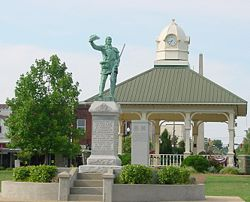 Town square in Lawrenceburg with a statue of David Crockett in the center.