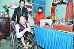 Le Thi Het receives support to boost her income from sewing. (6586869863).jpg