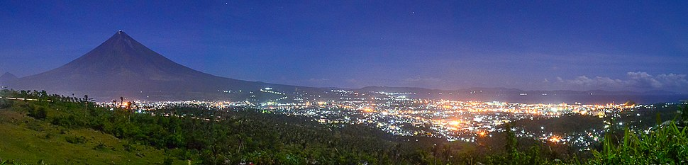 The nearly perfectly shaped Mayon Volcano and the city of Legazpi in Albay province