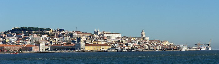 Partial view of old quarter of Lisbon, viewed from Cacilhas, showing the Praça do Comércio (bottom left), Castelo de São Jorge (upper left), and the Alfama district (including Monastery of São Vicente da Fora and Church of Santo Engrácia)