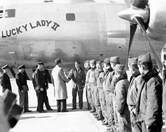 Lucky Lady II - Lucky Lady II crew members are greeted by Air Secretary Stuart Symington and General Hoyt Vandenberg