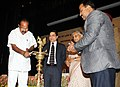 M. Veerappa Moily lighting the lamp to inaugurate the Rajiv Gandhi Advocates' Training Programme, in New Delhi. The Chief Minister of Delhi.jpg