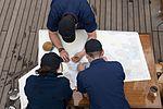 Making corrections to a nautical chart 110615-G-EM820-322.jpg