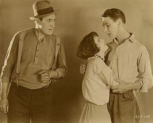 Mantrap (1926 film) - L-R: Ernest Torrence, Clara Bow, and Percy Marmont